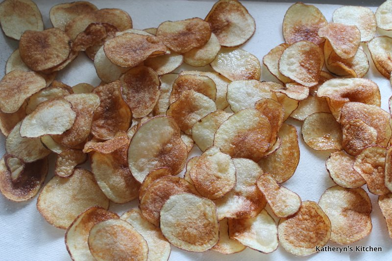 Fried Warm Potato Chips Draining on Paper Towelling
