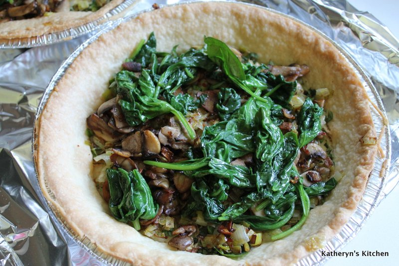 Cooked Spinach, Mushrooms and Leeks in Baked Pie Shell