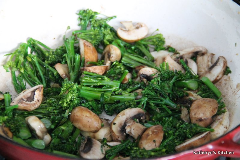 Broccolini and Mushrooms being Stir Fried